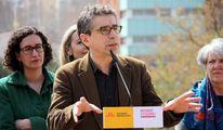 Jordi Martí con Marta Rovira al fondo